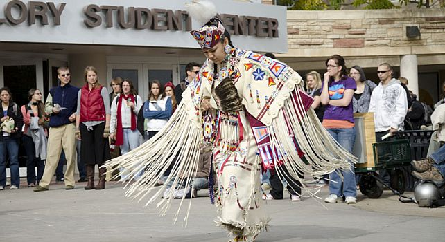 Woman dancer presents traditional dance at pow-wow